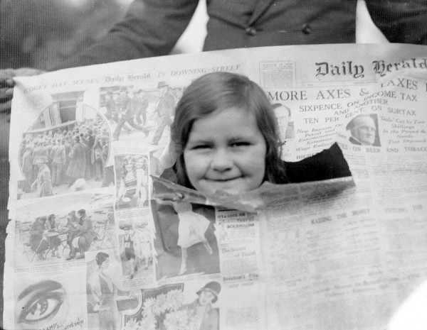 Girl's Head in newspaper